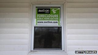 Auction sign in the window of a foreclosed property in Ohio