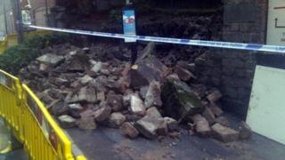 A wall in Arnold collapses after flash floods