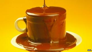 Cup overflowing with chocolate