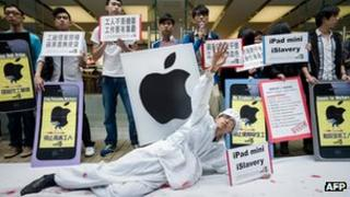 Protestors campaigning against working conditions in Apple suppliers'' factories