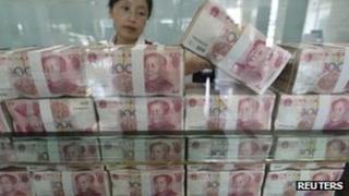File photo: Money at a bank in China