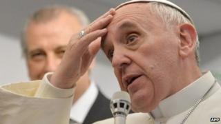 Pope Francis speaks to reporters during flight from Brazil
