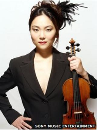Min-Jin Kym holding the Stradivarius violin that was stolen