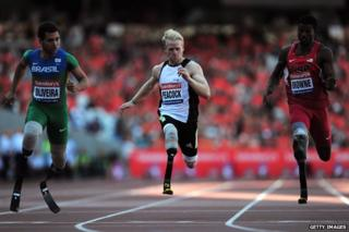 Jonnie Peacock competing in the T43/44 100 metres at the Anniversary Games on 28 July 2013