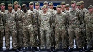 Members of the Royal Artillery holding a minute's silence for Corporal Rigby