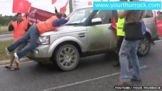 Protesters confront Boris Johnson's Land Rover