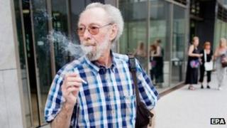 Friedhelm Adolfs smokes in front of the district court in Dusseldorf. Photo: 24 July 2013