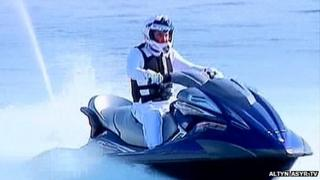 President Gurbanguly Berdimuhamedow riding a jet ski