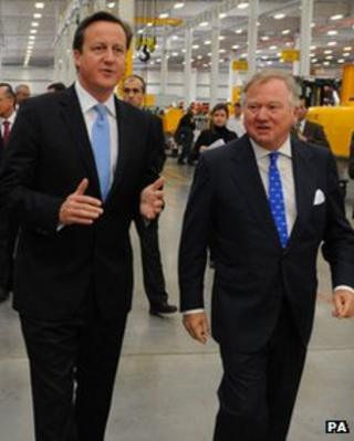 David Cameron and Sir Anthony Bamford visiting a JCB factory in Brazil in 2012