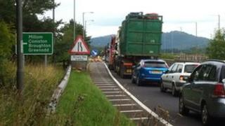 Queuing traffic on the A590 at Greenodd