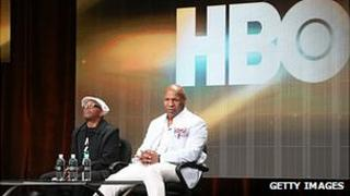 Mike Tyson and Spike Lee in front of a HBO logo