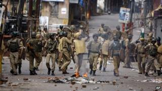 Indian paramilitary soldiers patrol during a protest against the state government after rival communities clashed in Kishtwar, in Jammu, India, Saturday, Aug. 10,2013