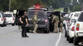 Louisiana law enforcement near bank during a hostage situation in St Joseph, on 13 August 2013