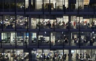 General view of office workers working late into the night