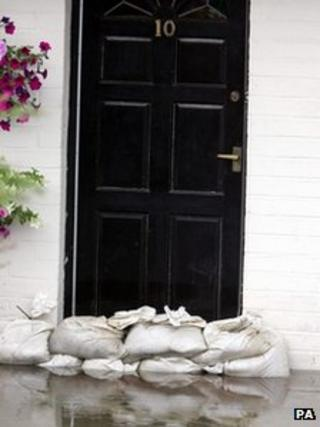 Sandbags against a front door as a flood defence