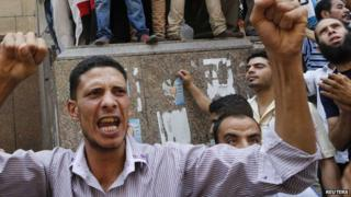 A supporter of deposed President Mohammed Morsi takes part in protest near Ennour Mosque in Cairo, 16 August 2013
