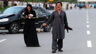 Muhammad Sikandar with his wife Kanwal during Thursday's shoot-out
