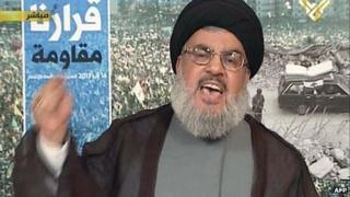 An image grab from Hezbollah's al-Manar TV shows Hassan Nasrallah, the head of Lebanon's militant Shiite Muslim movement Hezbollah, giving a televised address from an undisclosed location on 16 August, 2013 in Lebanon.