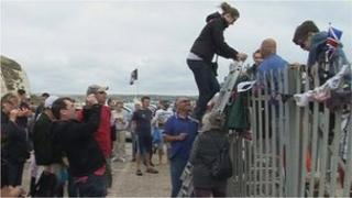 Campaigners climb over barriers