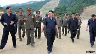 North Korean leader Kim Jong-un tours the construction site of the planned Masik ski resort with an entourage of military leaders