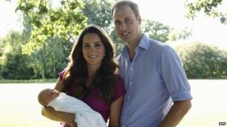 The Duke and Duchess of Cambridge pose with their son, Prince George.