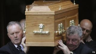David McLetchie's coffin is carried from the church