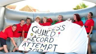 The team holding up a banner