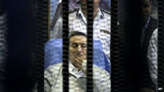 Former Egyptian President Hosni Mubarak attends an April hearing session in his retrial in Cairo