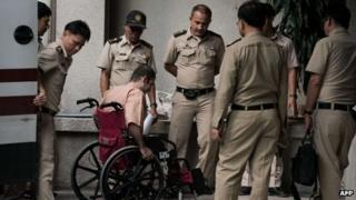 Saeid Moradi, 29, (in wheelchair), in Bangkok on 20 June 2013