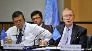 Michael Kirby (R), chairman of the UN Commission of Inquiry on Human Rights in North Korea, and Marzuki Darusman (L), listen to a former North Korean defector (not pictured) during a public hearing at Yonsei University in Seoul on 21 August 2013