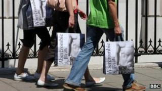 People walking with Abercrombie and Fitch bags