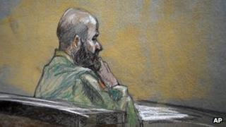 In this courtroom sketch, U.S. Army Major Nidal Malik Hasan is shown during closing arguments of his court martial, 22 August 2013