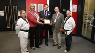 Reigate and Banstead mayor Dr Lynne Hack and Horley mayor Richard Olliver receiving the official plaque from British Taekwondo