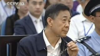 This screen grab taken from CCTV footage released on 26 August 2013 shows ousted Chinese political star Bo Xilai looking on as he stands on trial in the Intermediate People's Court in Jinan, east China's Shandong province