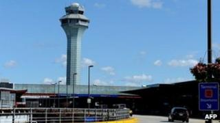 The air traffic control tower is seen behind the departures level of terminal 2 at Chicago's O'Hare airport on 13 August 2013