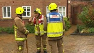 Firemen outside evacuated flats in Billericay