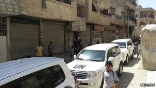 UN vehicles in the Damascus suburb of Mouadamiya