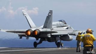 A US Navy F/A-18 Hornet plane takes off the USS Nimitz aircraft carrier. Photo: May 2013