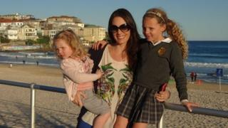 Kendall Hayes and her two daughters, at Bondi beach