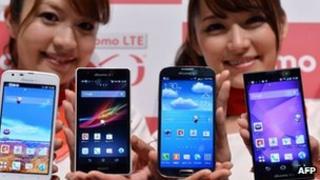 Models display various smartphones