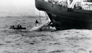 The Pisces craft hauled up after its rescue