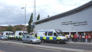 Police vans outside Racecourse stadium