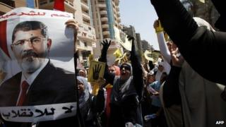 Supporters of ousted President Mohamed Morsi demonstrate in Cairo on 30 August