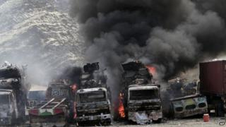 Smoke rises from NATO supply trucks following an attack by militants in the Torkham area near the Pakistan-Afghanistan border in Jalalabad province east of Kabul, Afghanistan, Monday, Sept 2, 2013.