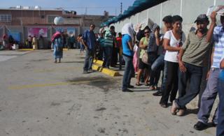 Queue outside a Maracaibo supermarket in Venezuela