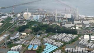 An aerial view shows Tokyo Electric Power Co. (Tepco's) tsunami-crippled Fukushima Daiichi nuclear power plant and its contaminated water storage tanks (bottom) in Fukushima, in this file photo taken by Kyodo 20 August 2013