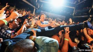 Macklemore crowd-surfing