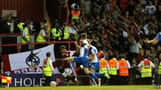 Police and stewards separating fans in the stands at Ashton Gate