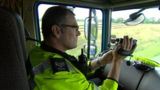 Police officer filming from the tractor unit