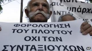 Cypriot protester holding banner
